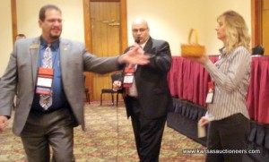 NAA representative Rich Schur rings while Shawn Terrel