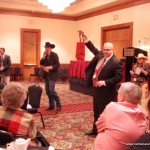 Blaine Lotz sells at the KAA Auxiliary fun auction